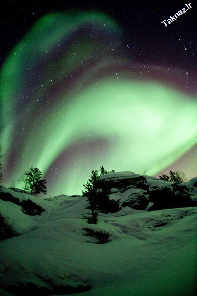 Photo: Aurora Borealis over Vee Lake, located outside Yellowknife,<br /> Northwest Territories